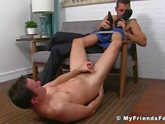 Nasty jock masturbating while licking feet of his lover boy
