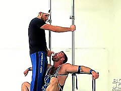 Aaron Cage gets all strapped up for some man to man action!