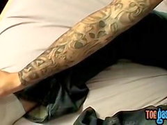 Inked stud Evan Heinze caresses feet and cock solo