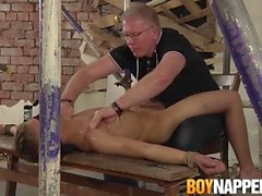 Old dom Sebastian Kane gives handjob to his lubed up slave