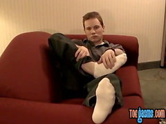 Young and handsome Tommy solo masturbates while showing his