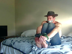 Cowboy ball-gagged